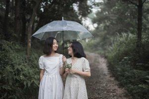 Two girls walking along a path