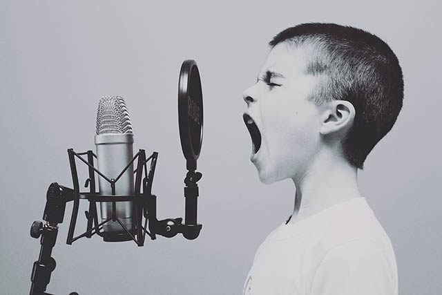 Child yelling at microphone