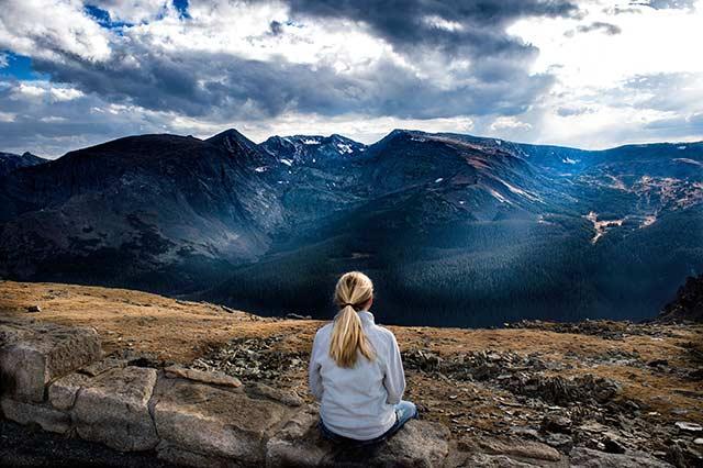 Woman looking over mountain range